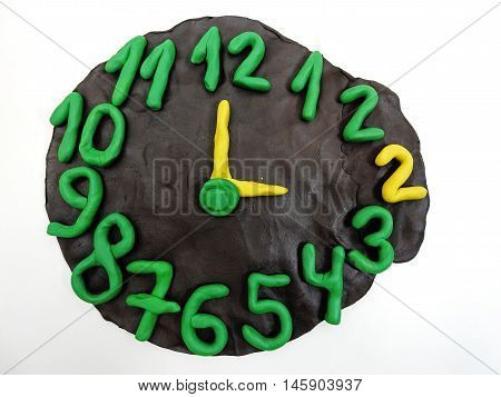 Round clock from plasticine going to winter time