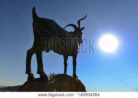goat statue sunrise and sun.sunrise and goat.