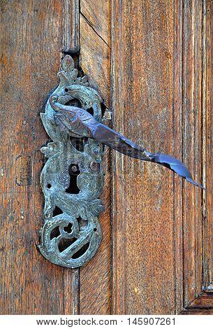 Old metal hand crank and wooden doors