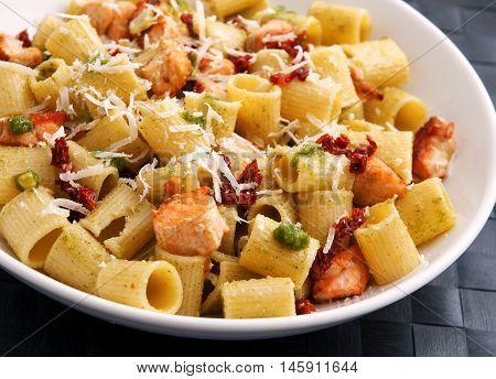 Italian Rigatoni with salmon and dried tomatoes. Horizontal shot