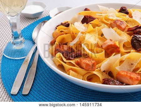 Italian Fettuccine pasta with salmon parmesan and dried tomatoes. Horizontal shot