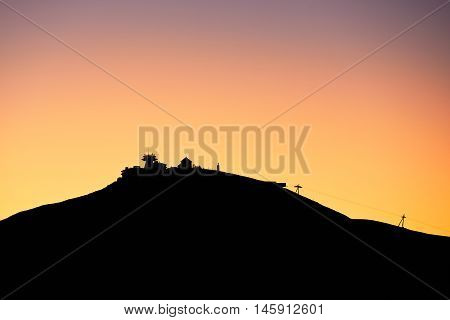 Amazing sunrise in the mounatins. Silhouette of the Snezka - the highest mountain in the Czech Republic.