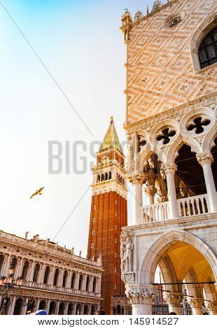 San Marco square with Campanile and Doge Palace at sunset. Venice, Italy.