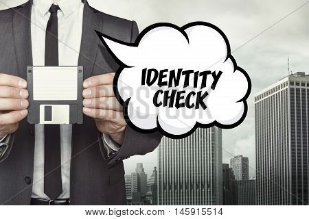 Identity Check text on speech bubble with businessman holding diskette