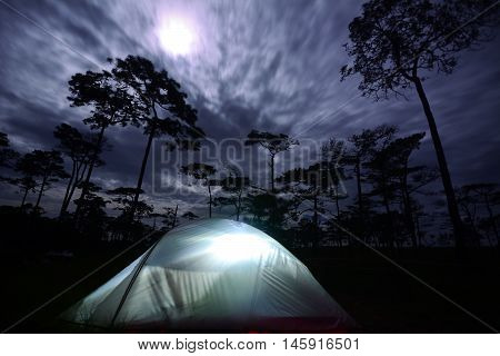 Camping with tents on the mountain in the moonlight at Phu Soi Dao, Thailand.