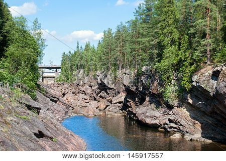 Imatra. Finland. The canyon of Imatrankoski (The Imatra Rapid) on The Vuoksi River. On the right side is Kruununpuisto Park.