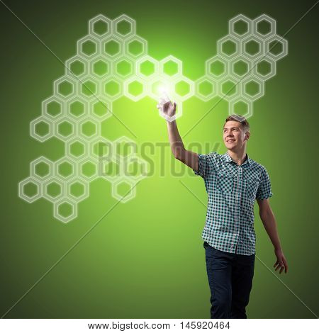 Young man touching icon of cellular on screen