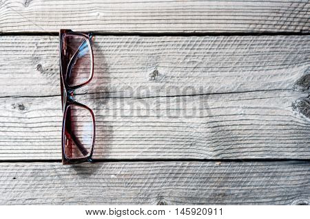 Soft Focus Wooden Work Table With Glasses,