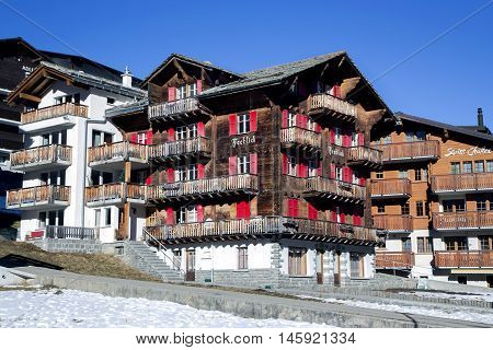 SWITZERLAND, SAAS-FEE, DECEMBER, 26, 2015 - Modern wooden hotels on a bright sunny day in the charming Swiss resort of Saas-Fee, Switzerland