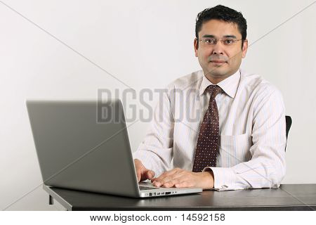 Indian Businessman Working On Laptop