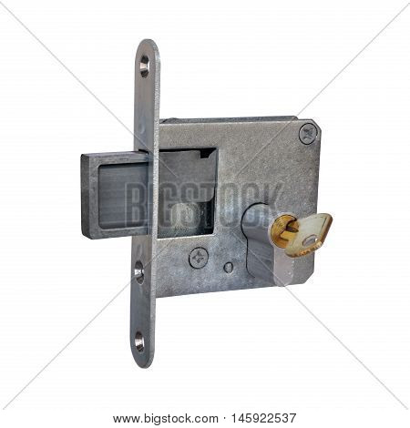 Old mortise door lock with brass key on a white background
