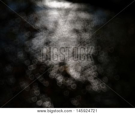 dark background and blurred bright glare black