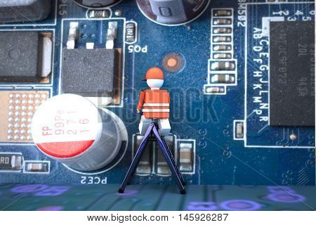 Worker Puppet On A Computer Motherboard
