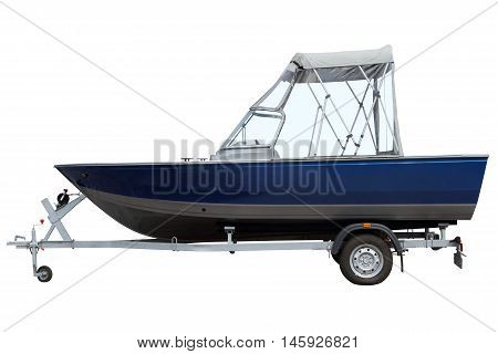 Motor boat with a canvas tent loaded on a trailer for transportation.