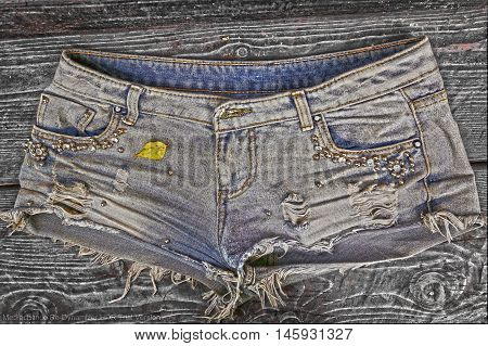 shabby denim stylish shorts close up photo