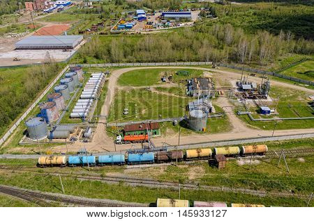 Bogandinskoe, Russia - June 23, 2016: Bird eye view onto firm on pouring of gasoline of oil refinery. Tyumen region