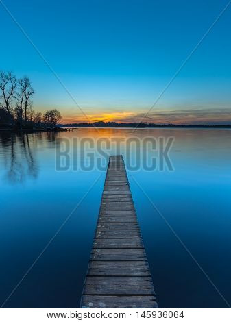 Sunset Over Wooden Jetty In Groningen, Netherlands