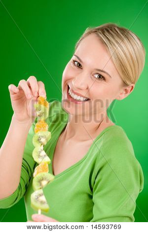 Healthy Lifestyle - Woman Eating Kiwi And Orange