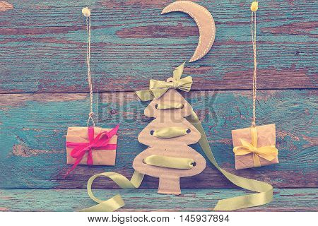 Christmas decorations with fir tree balls and gifts on wooden boards painted in blue.