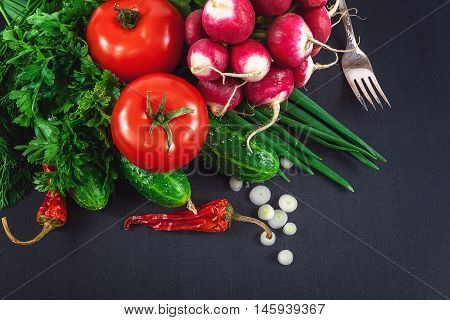 Fresh vegetables on the a black background.