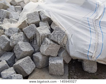 Pile Of Cobblestones With A Cracked Cotton Sack