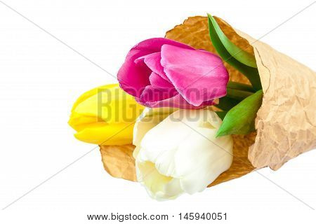 Bouquet of fresh tulips in paper packing isolated on a white background.