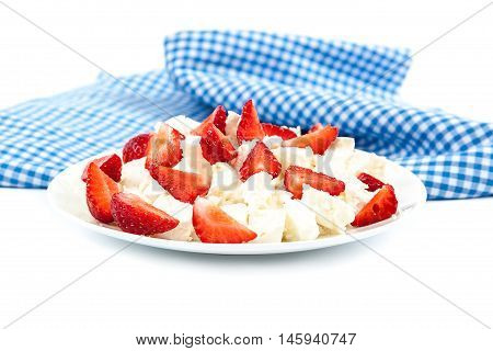Fresh sliced strawberries in a cottage cheese in a bowl isolated on white background.