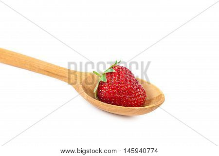 Fresh strawberries in wooden spoon isolated on a white background.