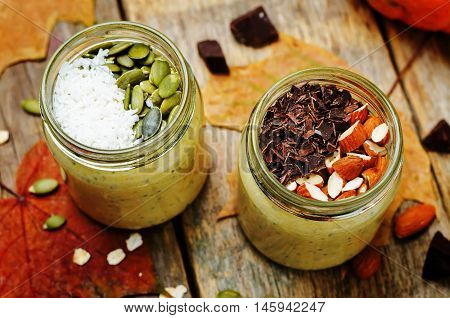 pumpkin chia seeds overnight oats on wooden background