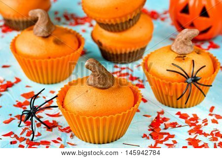 Pumpkin cupcakes for Halloween party. Festive treats for kids composition