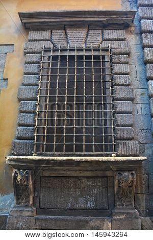big old barred window in Lucca Italy