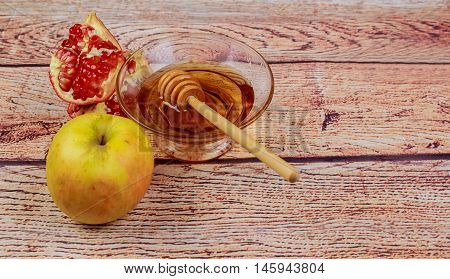 Rosh Hashanah Jewesh Holiday Torah Book, Honey, Apple And Pomegranate Over Wooden Table. Traditional