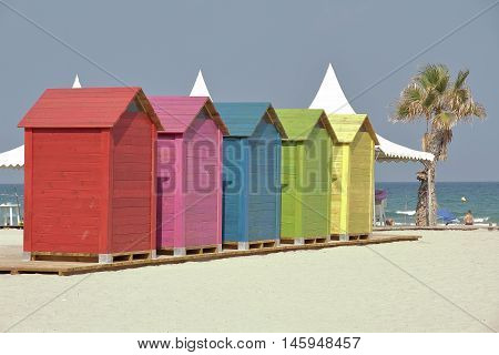 row of colorful changing cabins on the beach