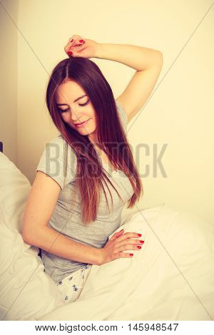 Attractive Woman In The Bed.