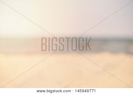 Blur Summer White Sand Beach With Sea Water. Abstract Bokeh Blurred On Colorful Background. Space Fo