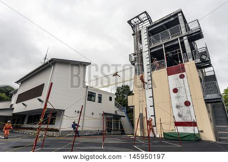 NIKKO, JAPAN - MAY 10, 2016: A group of Japanese men go through training drills to become firefighters