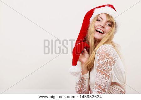 Happy smiling cute pretty woman girl in santa helper hat. Christmas xmas.