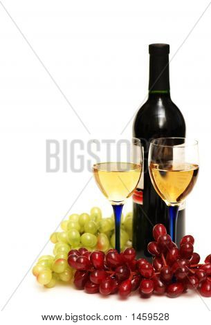 Two Glasses Of Wine, Bottle And Grapes Isolated On White