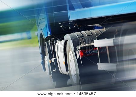 Semi Truck Spedition. Speeding Semi Truck on the Highway. Closeup Photo. Heavy Duty Transportation.