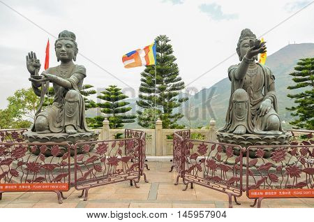 HONG KONGHONG KONG - December 8 2013:two of the Six Devas praising and making offerings to the Tian Tan Buddha.