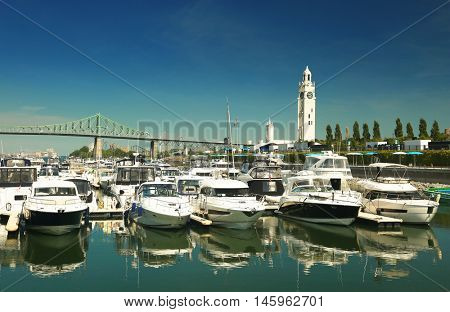 View of the marina with the clock tower in background in the old port of Montreal in Quebec city, Canada