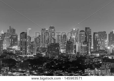 Bangkok city at night with illuminated skyscrapers.