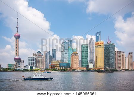 SHANGHAI-JUNE 2, 2012. Huangpu River and Pudong district seen from Bund. The Pudong district houses Lujiazui Finance and Trade Zone and the Shanghai Stock Exchange, it is China's financial center.