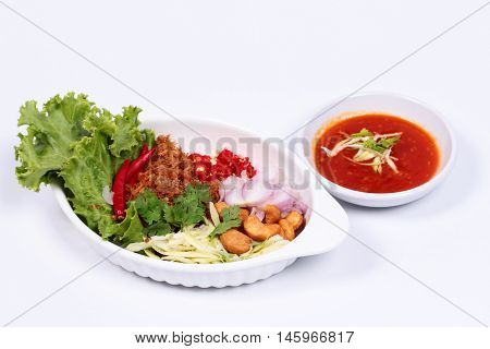 Crispy tuna salad on white background. (Fried crispy tuna  with green mango , red onion,cashew nut and chili)