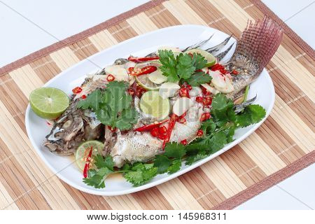 Tilapia fish streamed lemon is food for good life on Chinese festival.