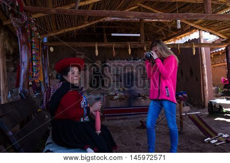Tourist Taking A Picture Of A Native Peruvian