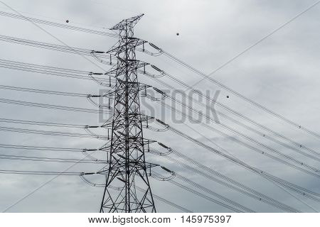 Electric pole in the sky was overcast in raining day coming