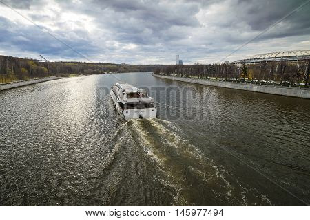 Moscow, Russia, April, 22, 2016. Modern Radisson pleasure craft make excursions across Moscow river all year round. In the spring, cloudy day, the poor light.