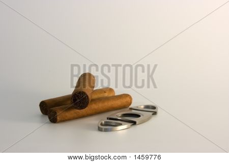 3 Cigars And A Cutter