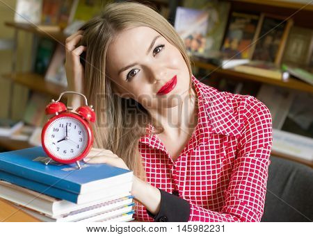 Girl Student With Books For An Alarm Clock, Doing Homework, Preparing For Exams